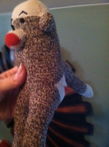 sock monkey missing an arm